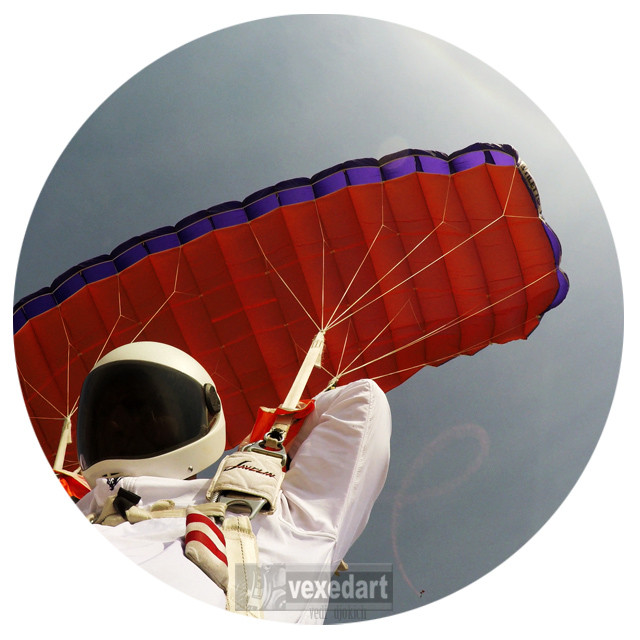 skydiver artist flying his parachute |