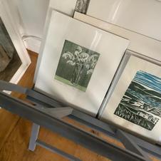 Unframed  etchings  in the rack.