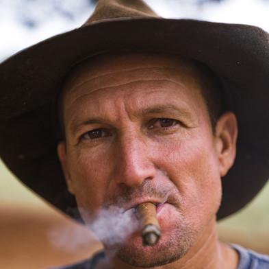 Farmer with cigar_orange skin tone.jpg