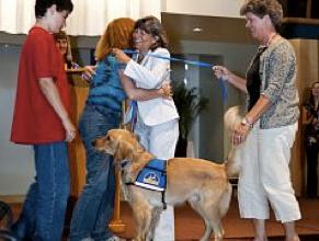 Vico and Moira thank Navarro's Puppy Raisers during graduation. Photos by Ken Sergi Photography