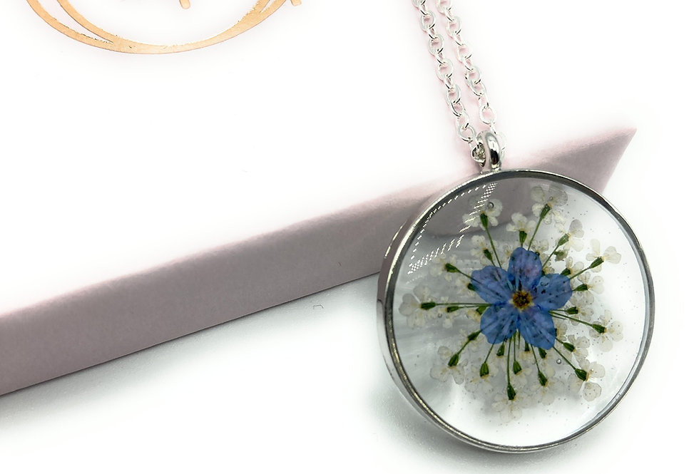 Round Forget Me Not Flower Keepsake Pendant and silver necklace