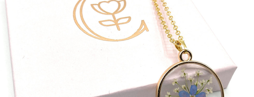 Round Forget Me Not Flower Keepsake Pendant and gold-plated necklace