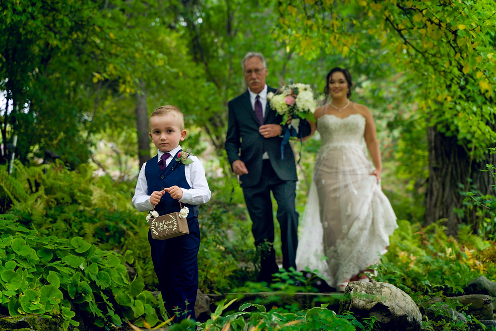 Ring Bearer ahead of the Bride and Father at Reader Rock Garden, Wedding Venuein Calgary