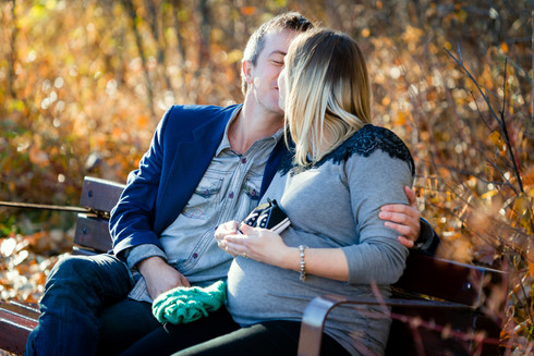 Fall Maternity - Couple Kissing on a Bench