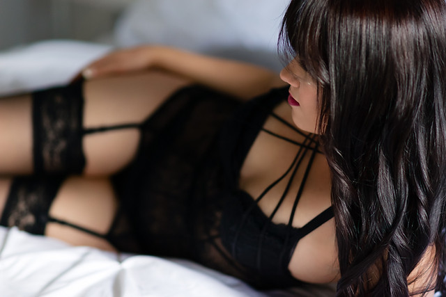 Christmas Boudoir - Woman in Black Lingerie posing on a bed