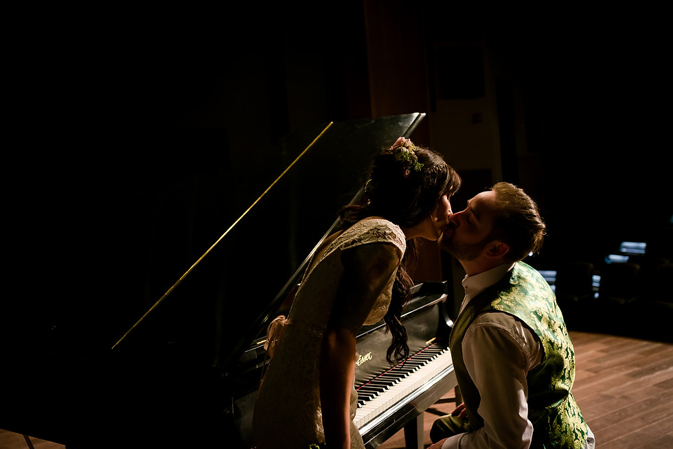 Shawna and Tom Elopement Wedding - Bride and Groom Kissing over the Piano