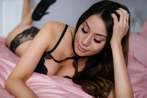 Valentine boudoir photo - Woman in black lace top and panties