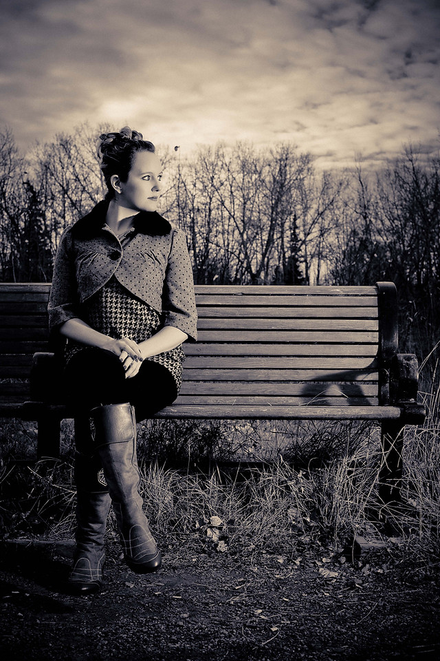 Lonely woman on a bench in a desolate area