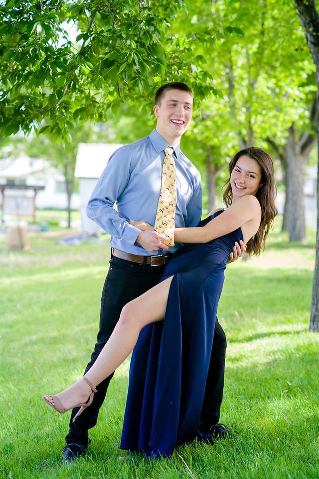 Graduating couple celebrating during their grad photos - Ecole de la Source graduation 2020