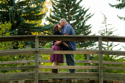 Fall Engagement Kiss on a Bridge