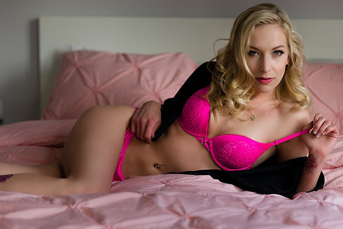 A little tease, woman in hot pink lingerie two piece