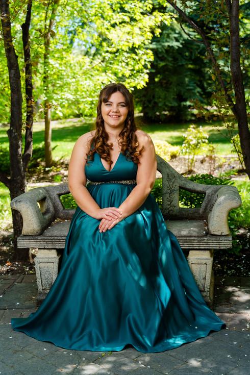 Kristin in her grad dress in a flower garden