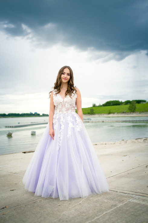 New Grad in her purple & white graduation dress for her grad photo session