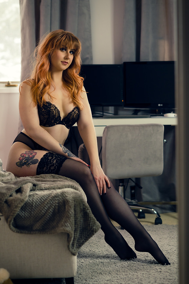Redhead Boudoir in Black Lingerie and Garters