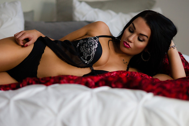 Boudoir - Woman in Black lingerie and red lipstick for boudoir