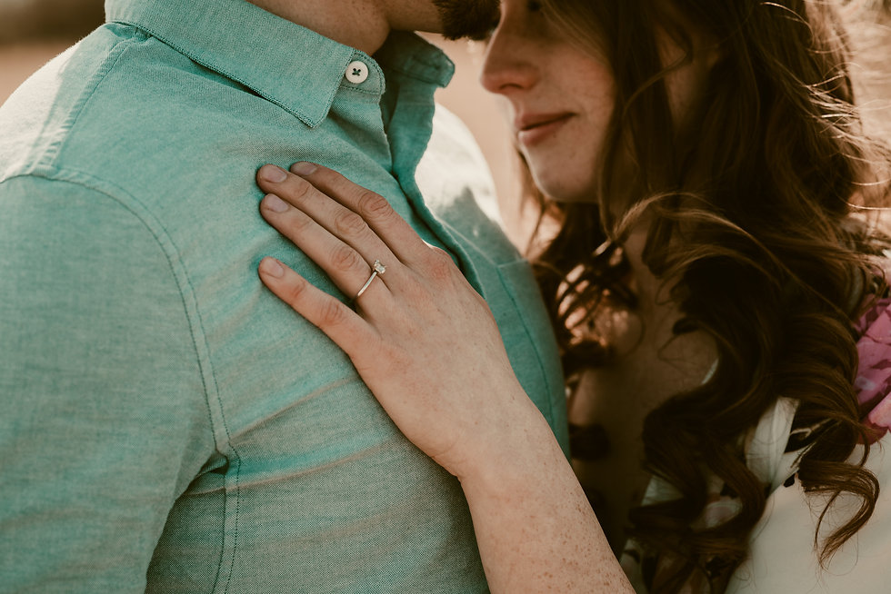 Couple sharing a tender moment with engagement ring in picture, for their engagement photo session - Photo taken by Pierre-Luc Cormier Photography
