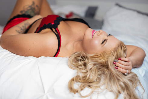 Pin up style Boudoir - Blonde Woman in Red Lingerie Two Piece Outfit