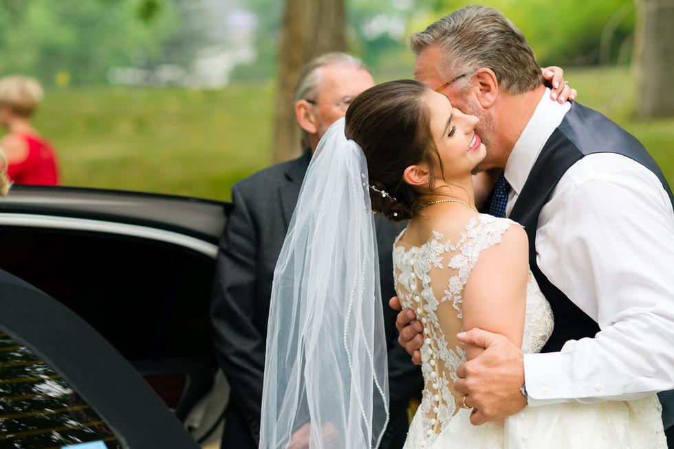 Cloe and Josh Fairytale Wedding in Calgary - Bride Hugging Father