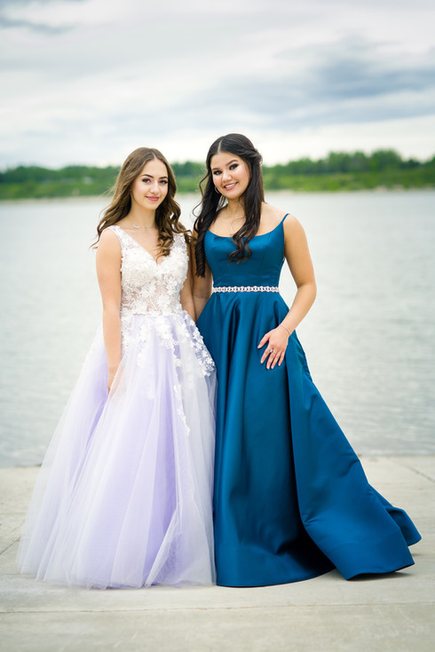 New Grads in their white and blue graduation dresses for their grad photo session - winners of our grad photo giveaway with hair and makeup by Glam and Beyond