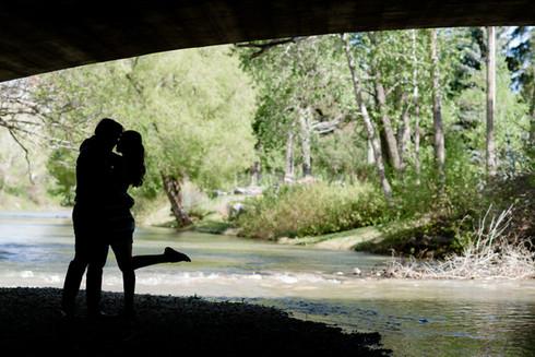Silhouette - An engagement kiss under the bridge