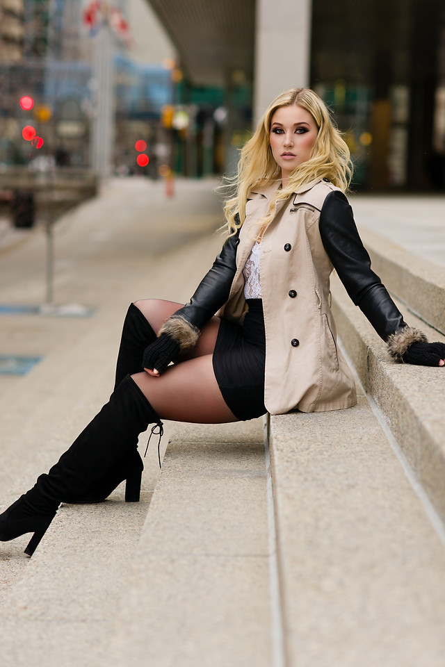 Megan of Numa Models in knee high boots and black pencil skirt
