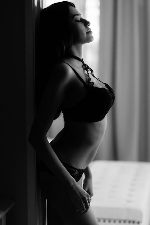 Dream black and white lingerie boudoir portrait in our Calgary home studio