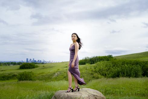 New graduate in purple grad dress