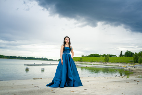 New Grad in her blue graduation dress for her grad photo session