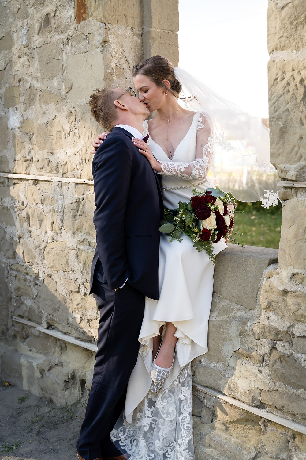 Bride and Groom Svetlana and Konstantin kissing at the Rundle Ruins in Calgary wedding photos