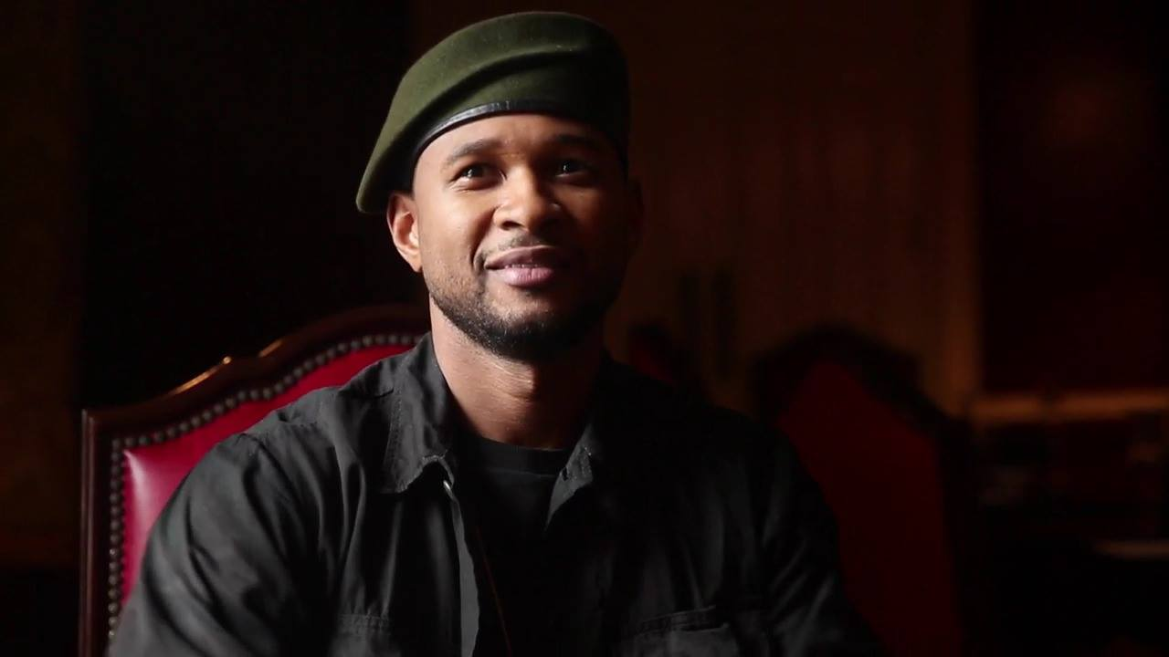 Usher has fun, chatting about onesies