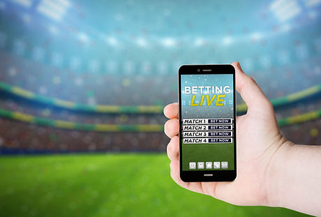 Hand hold a phone with  betting online o