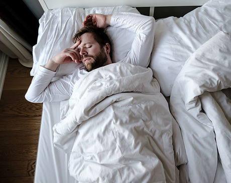 Bearded man sleeps restlessly in bed, he