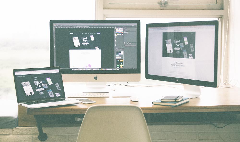 Designer computers creating website content