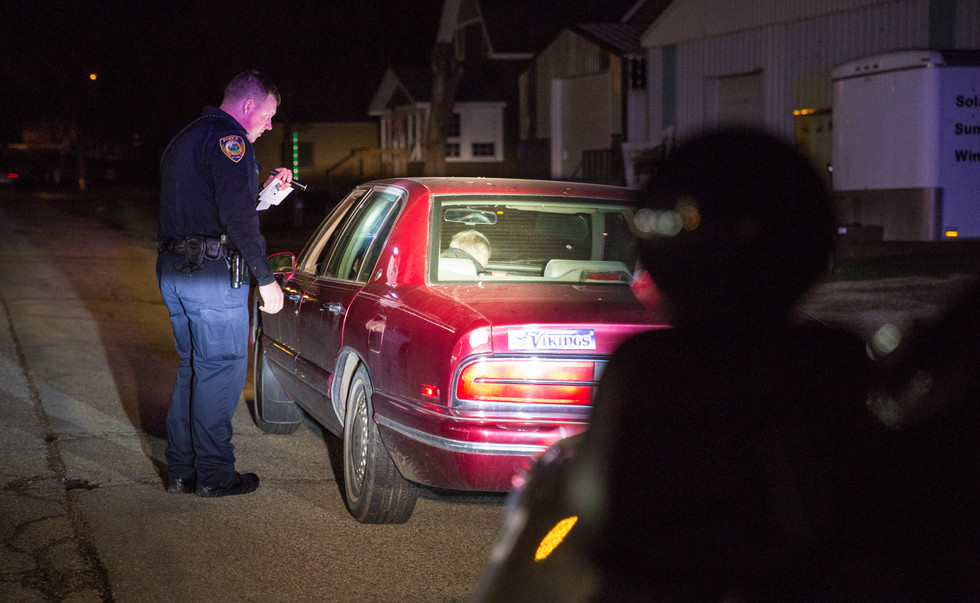 WPD Corporal Scott Price pulls over a vehicle for a traffic violation near 5th St. NE on May 11, 2018. The driver ended up being taken in for a DUI. ©2018 Grace Ramey