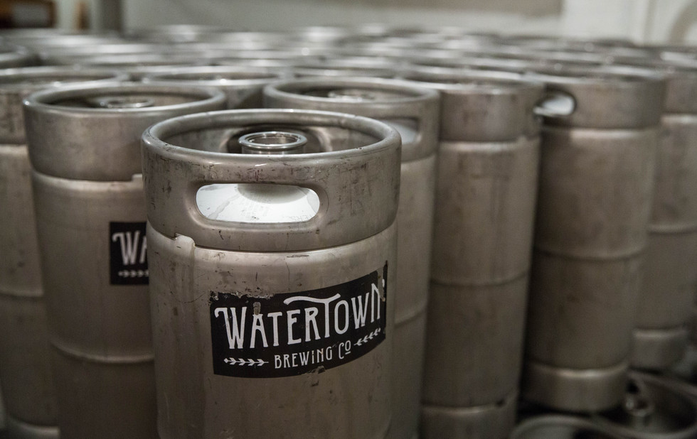Kegs of beer sit in the basement of the Watertown Brewing Co. The restaurant almost always has five handcrafted beers on tap at a time, typically the Kampeska Cold Brew, the Codington Cream Ale and three other specialty brews. ©2018 Grace Ramey