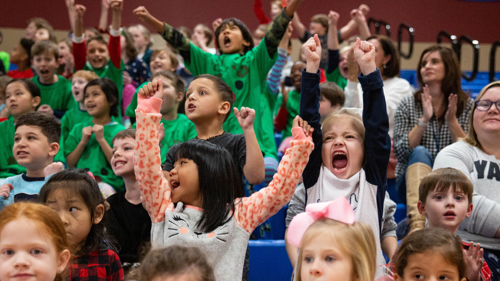 """Jody Richards Elementary School students cheer for their classmates during the """"Pennies for Patients"""" fundraiser basketball game against JRES teacher Jen Green's son Seth and his friends for the Leukemia Lymphoma Society on Friday, Dec. 20, 2019, in the school's gymnasium. ©2019 Grace Ramey"""