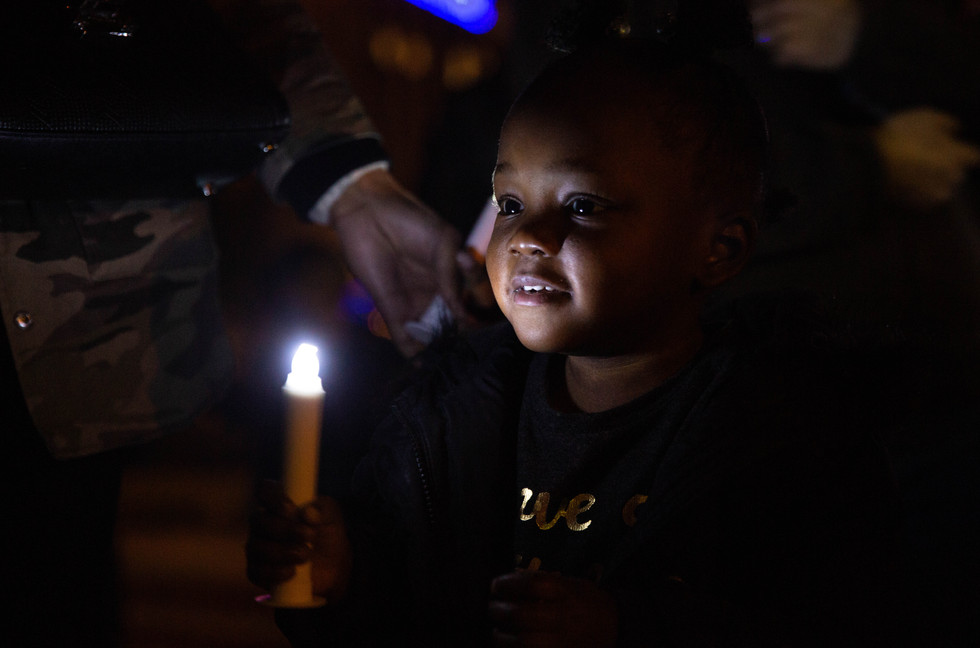 Tatum Huffman, 2, of Bowling Green holds up her LED candle before the lighting of the Christmas tree outside the Med Center during the 2019 Make the Season Bright tree-lighting ceremony on Tuesday, Dec. 3, 2019. All the lights on the tree are in honor of or in memory of someone special. ©2019 Grace Ramey