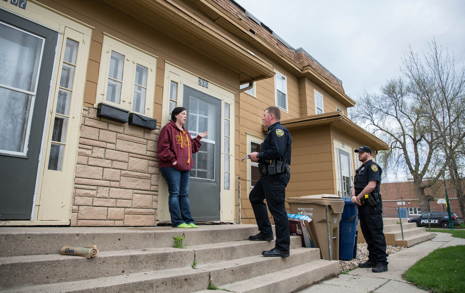 Watertown resident Kristina Hines talks to WPD officers Scott Price, middle, and Shane Hardie about a civil dispute with her ex-boyfriend. WPD respond to a variety of calls, including bar fights, drug possession and burglary, while also patrolling for traffic violations, DUIs and much more. ©2018 Grace Ramey