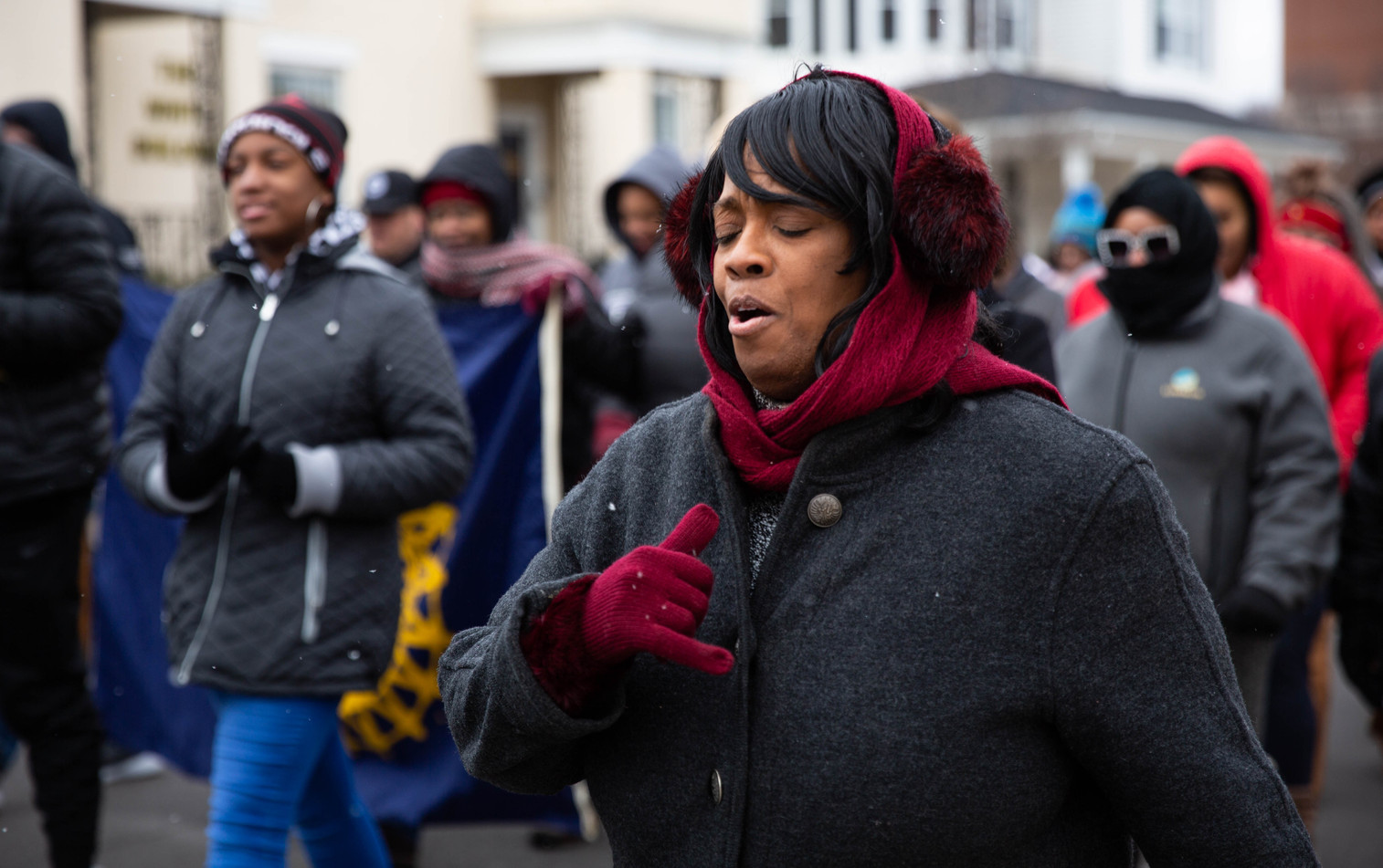 Felicia Bland of the MLK Planning Committee sings along with others participating in the Martin Luther King Jr. Day March, which started at the Warren County Justice Center and ended with a celebration ceremony at State Street Baptist Church, on Monday, Jan. 20, 2020. ©2020 Grace Ramey