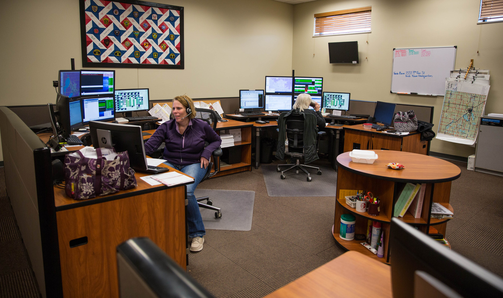 Dispatchers Lori Sein, left, and Theresa Riter answer calls in the Watertown Police Department call center on May 11, 2018. The call center, which covers an average of calls from Codington, Hamlin, Clark, Deuel, Grant and Roberts counties, has two to four dispatchers working 8-hour shifts at a time. ©2018 Grace Ramey