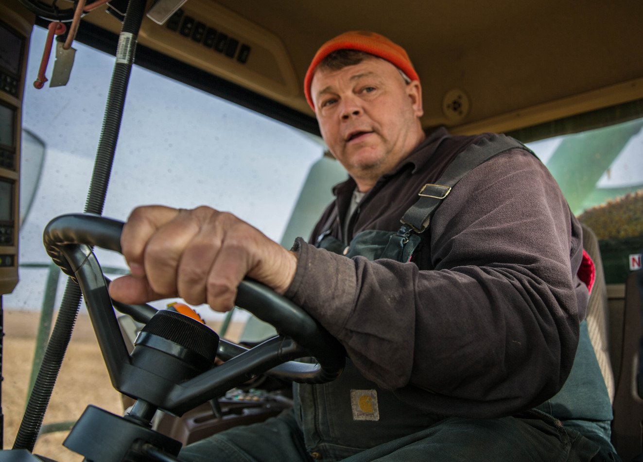 Jim Thyen drives the 12-row combine through one of the Thyen farm fields during the dry corn harvest on Tuesday, Oct. 31. Jim and his brother, Dan, who own their family's farm in Waverly, have farmed their whole lives. ©2017 Grace Ramey