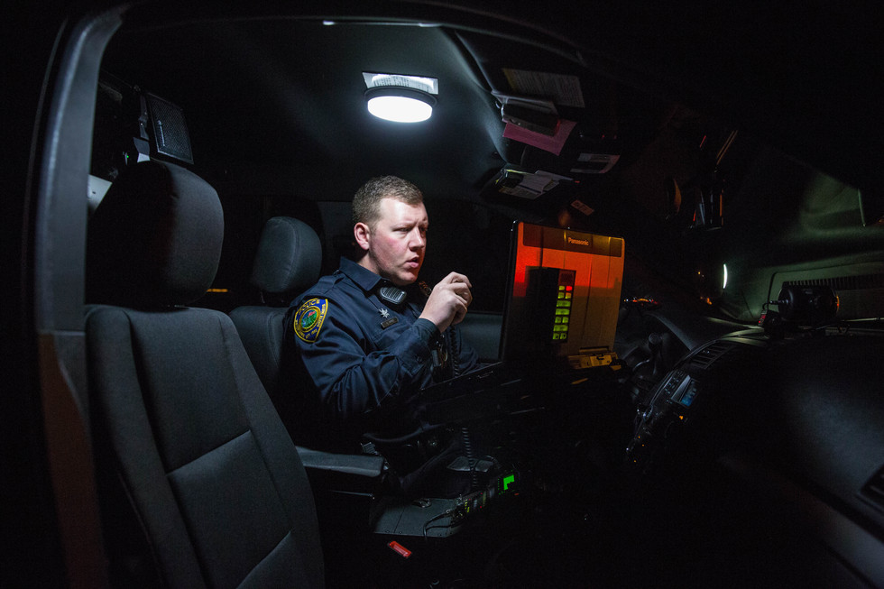 WPD Corporal Scott Price radios a dispatcher after pulling over a vehicle that was speeding on 19th St. NE on May 11, 2018. ©2018 Grace Ramey