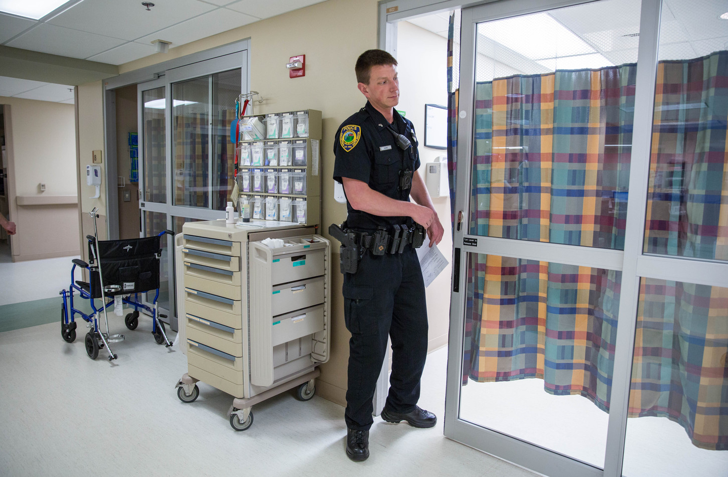 Corporal Jeremy Bjerke checks on a man the WPD and WFR brought in to Prairie Lakes Hospital Monday for making threats to himself and others on May 14, 2018. The man was later transported to Serenity Hills Halfway House, a care facility in Watertown for those suffering from mental illness and/or addictions. ©2018 Grace Ramey