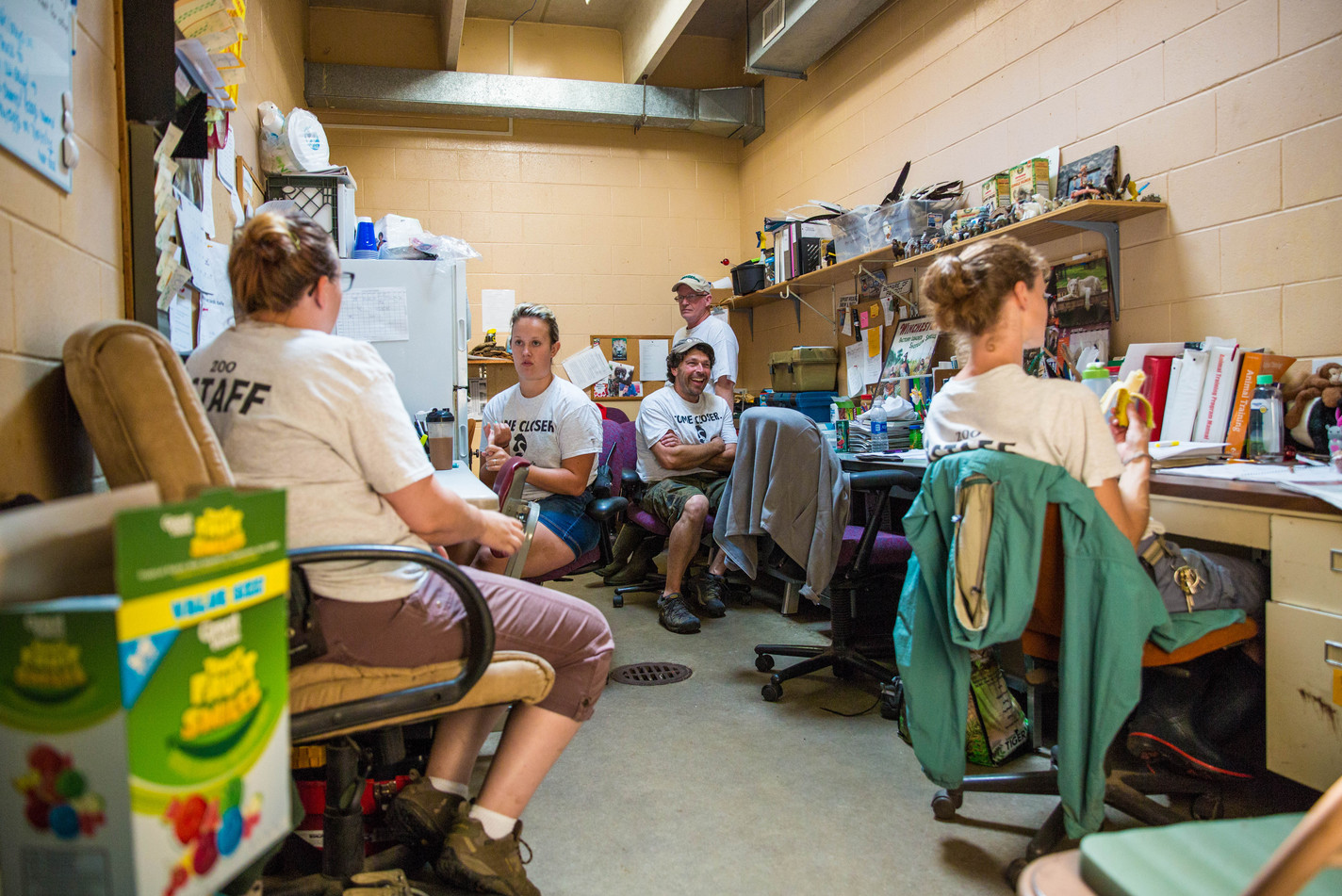 (From left) JoJo Crane, Olivia Reimers, John Gilman, Bill Gallagher and Jen Giessinger take a break after cleaning all the enclosures for the day and discuss plans for the day on Wednesday morning, Aug. 2 at Bramble Park Zoo. ©2017 Grace Ramey