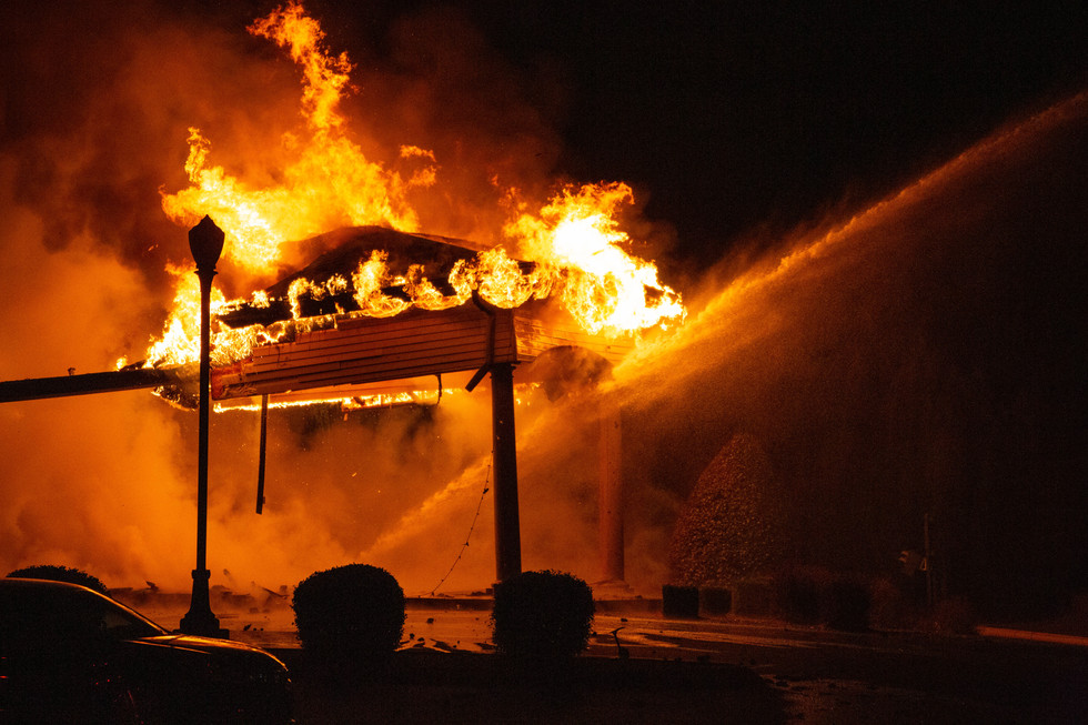 Flames engulf Indian Hills Country Club in Bowling Green on Saturday night, Dec. 7, 2019. According to Bowling Green Fire Department Deputy Chief Rob Gilliam, eight units from the BGFD and volunteer units from Alvaton Fire Department and Gott Fire Department worked throughout the night to extinquish spot fires, secure unstable areas and investigate the origin of the fire. ©2019 Grace Ramey