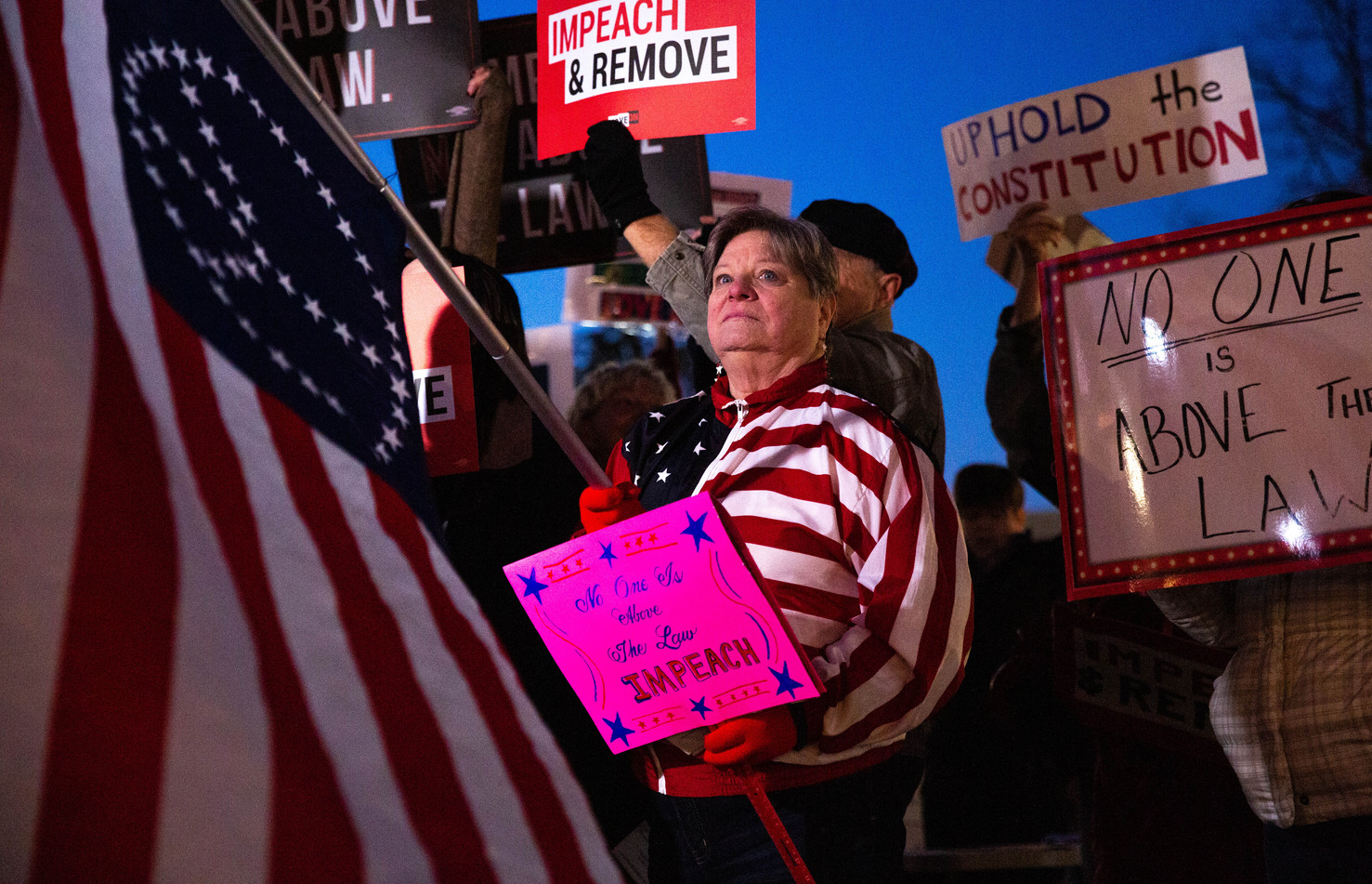 "Claudia Hanes of Bowling Green and other local activists gather in Fountain Square Park on Tuesday, Dec. 17, 2019, for a ""Nobody is Above the Law"" rally to support the impeachment and removal of President Donald Trump. ©2019 Grace Ramey"