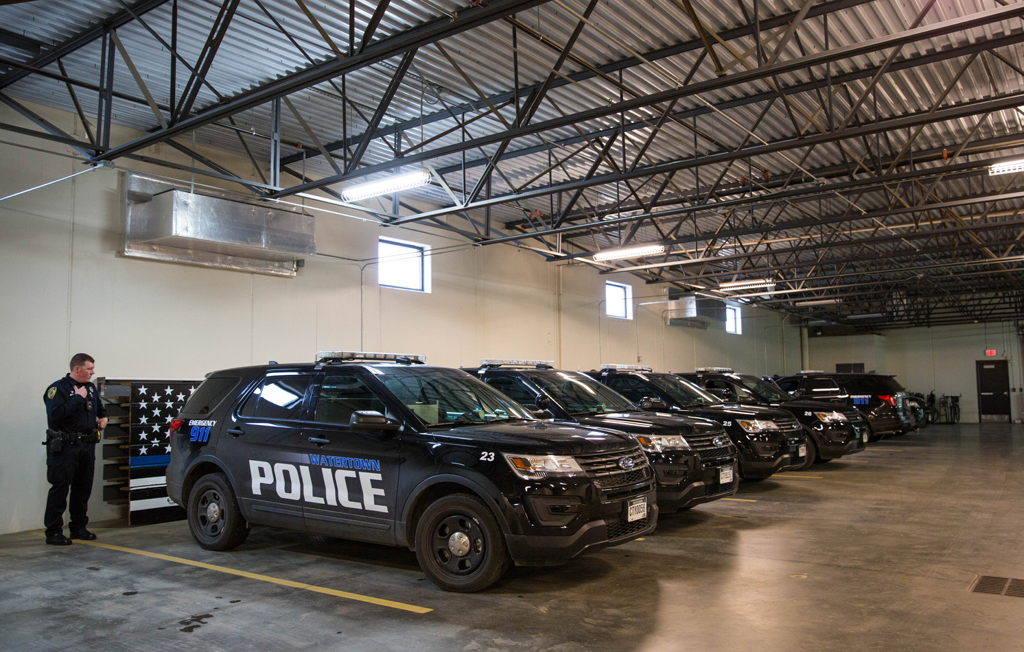 Corporal Scott Price reports in on his radio in the WPD garage before starting his shift on May 11, 2018. The department has 11 marked patrol cars, seven or eight unmarked cars, an animal control truck, a SWAT truck, a police motorcyle, a UTV and other utility vehicles. ©2018 Grace Ramey