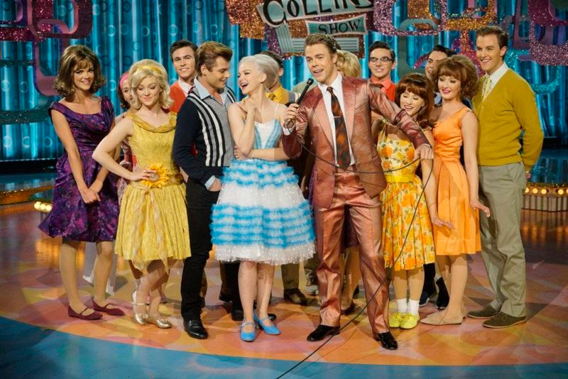 HAIRSPRAY LIVE! -- Pictured: (l-r) Garrett Clayton as Link Larkin, Dove Cameron as Amber Von Tussle, Derek Hough as Corny Collins -- (Photo by: Paul Drinkwater/NBC)