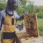Erik sporting his new beekeeping apron m