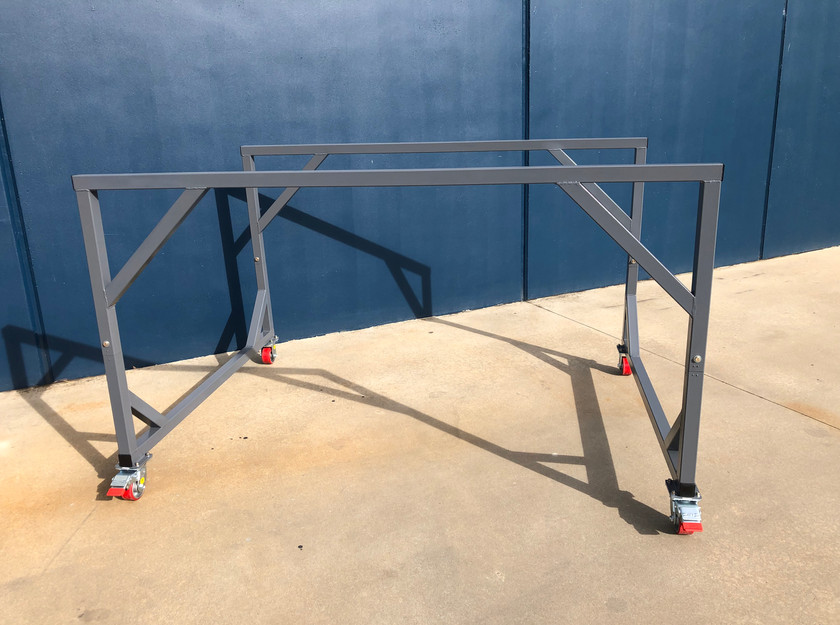 Portable double-deck trolley for open wheel racing cars.